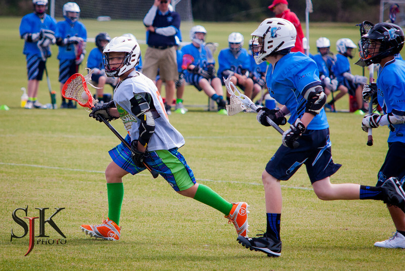 IMAGE: http://sjkphoto.smugmug.com/Sports/Lacrosse/Monsters-Lacrosse/February-15th-Monsters-U13U-1/i-qQWG87t/0/L/IMG_1363-L.jpg